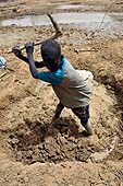 Little boy working in a brickyard in Petaka, Mali. 