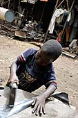 Child tinsmith working in Soukounicoura area. Bamako, Mali.