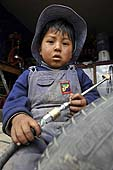 Young boy, mechanic. La Paz (Alto), Bolivia. 