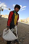 Young boy carrying stones. La Paz (Alto), Bolivia.