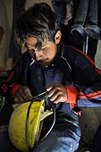Young boy getting ready to work in a coal mine in Potosí, Bolivia.