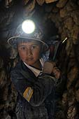 Young boy working in a coal mine. Potosí, Bolivia.