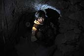 Young boy working in a coal mine in Potosí, Bolivia.