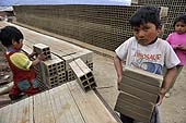 Children carrying bricks in a brickyard in La Paz (Alto), Bolivia.