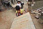 Young boys working in a brickyard in La Paz (Alto), Bolivia.