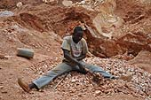 A child working in a stone quarry, Wakiso district, Uganda