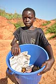 Child of 10 years old selling samosas to the workers at the quarry, Wakiso, Uganda