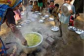 This photo is the result of a photographic competition organized by the International Labour Office New Delhi branch to promote decent work for domestic workers. Original caption by the author: Midday Meal: Woman is serving the meal at children's school.