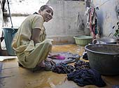 This photo is the result of a photographic competition organized by the International Labour Office New Delhi branch to promote decent work for domestic workers. Original caption by the author: Paraplegic happy and able to work: The young woman was paraplegic and could not walk unaided. Here I have tried to show the enthusiasm with which she was working and the radiance in her smile that says 'I may be incapacitated but I am capable*. The image portrays the eagerness of disable people wanting to integrate into the larger society, which continues to reject them.