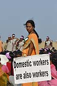This photo is the result of a photographic competition organized by the International Labour Office New Delhi branch to promote decent work for domestic workers. Original caption by the author: Domestic workers are also workers: Around four thousand Domestic workers gathered in Marina Beach 'Chennai' demanding dignity of their work and life. The lady in this photo has been a great inspiration for many, fighting for their rights and minimum wages.