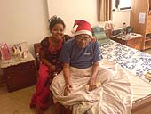 This photo is the result of a photographic competition organized by the International Labour Office New Delhi branch to promote decent work for domestic workers. Original caption by the author: Grandfather Christmas!: When Daddy got old and had to be brought-up all over again, Sheetal proved to be an indispensable ally.