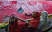 This photo is the result of a photographic competition organized by the International Labour Office New Delhi branch to promote decent work for domestic workers. Original caption by the author: Our work is beautiful : all these village women niddle worker engaged with 'JARDAUSI' saree stitching with hands
