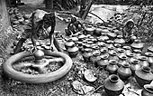 This photo is the result of a photographic competition organized by the International Labour Office New Delhi branch to promote decent work for domestic workers. Original caption by the author: Pot Maker: They live very near the earth and making the earthen goods.