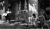 This photo is the result of a photographic competition organized by the International Labour Office New Delhi branch to promote decent work for domestic workers. Original caption by the author: House Worker: Unorganised labour in urban area.