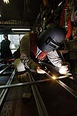 Welder fusing metal. Kyoto, Japan.