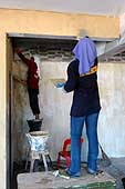Female workers on a housing renovation site. Thailand.