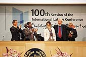 Delegates and the Director-General of the ILO, Mr. Juan Somavia, congratulate Ms. Manuela Tomei, Director, ILO Conditions of Work and Employment Branch, following the final result of the vote on the Convention on Domestic Workers. International Labour Conference, 100th Session, Geneva, Thursday 16 June 2011.