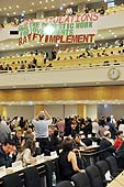 Delegates rejoicing after the final result of the vote on the Convention on Domestic Workers. International Labour Conference, 100th Session, Geneva, Thursday 16 June 2011.
