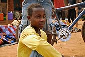 A young boy selling clothes at the market in TA Nthiramanja, Mulanje district, Malawi
