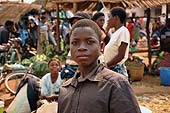A young boy selling plastic bags at the market in TA Nthiramanja, Mulanje district, Malawi.