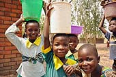 Boys and girls carrying water back home in a village in Mulanje district, Malawi.