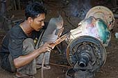 Welder. City of Yangon (Rangoon). Report from Myanmar, May 2013.