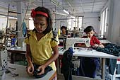School uniform manufacture that uses child labour. Only 3 of the young employees are above 18. City of Yangon (Rangoon). Report from Myanmar, May 2013.