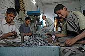 Children working in workshop manufacturing surgical instruments for export. Sialkot. Pakistan