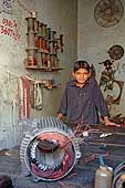 Child working in a winding machine workshop. Sialkot. Pakistan