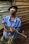 Child soldier. Most of these children are illiterate but know how to fire a gun. Democratic Republic of the Congo.