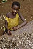 Girl sorting out some dried fish. Democratic Republic of the Congo.