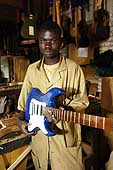 Former child soldier who has benefited from the ILO's International Programme on the Elimination of Child Labour (IPEC). Demobilized in 2003, he is now working for the vocational training centre CAPA and produces electric guitars. Bukavu. Democratic Republic of the Congo.
