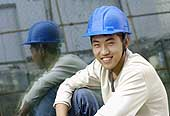 Portrait of a worker on a construction site. Beijing. China.