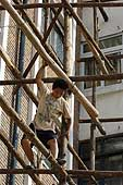 Hazardous work on wooden scaffoldings. Building reconstruction and renovation site. Tianjin. China.