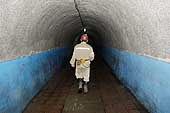 Miner in a tunnel. Kailuan Coal Mine Group. Tangshan Qianjiaying Coal Mine. China. 