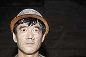 Portrait of a pit worker. Kailuan Coal Mine Group. Tangshan Qianjiaying Coal Mine. China.