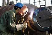 Welder at Hangzhou Boiler Group Co. Boilers manufacturer. Hangzhou, China.