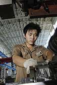Worker at Hangzhou Steam Turbine Co., the largest producer of industrial steam turbines in China. Hangzhou. China.
