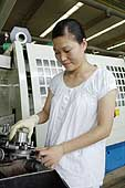 Pregnant woman. Wanxiang Qianchao Co. production site. Founded in 1969, it is one of the largest manufacturers of automotive parts in China. Hangzhou. China.
