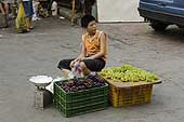 Young boy selling fruits in the street. City of Chengdu. China.