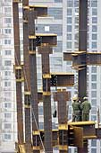 Workers on a building construction site. City of Beijing. China.