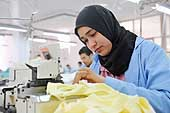 Seamstress at SEKEM. The company produces and manufactures its own products including herbs, pharmaceuticals, and textiles.