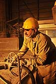 Man working on a blast furnace. Ezz Steel plant is located in Alexandria and employs more than 2000 skilled workers. It is the Middle East's leading producer of high quality long and flat steel for use in a wide range of end applications.