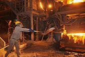 Worker feeding the blast furnace. Ezz Steel plant is located in Alexandria and employs more than 2000 skilled workers. It is the Middle East's leading producer of high quality long and flat steel for use in a wide range of end applications.