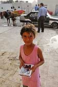 Cairo. Young girl selling postcards on the street.