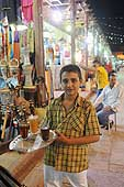 Egypt. Young boy serving tea in the street.