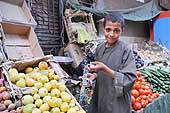 Cairo. Moqattam, home to many of Cairo's Zabaleen or rubbish collectors. A young fruit and vegetable seller.