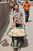 Cairo.Moqattam, home to many of Cairo's Zabaleen or rubbish collectors. Boy selling bread in the street.