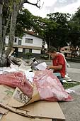 Victor, 11, sorting garbage to sell for recycling. Medellin (Antioquia), Barrio La America, Colombia.