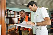 Inspection of the 'Jolly Blu'. Captain with lieutenant Paolo Leone, port state control officer (PSCO). Port of Genoa.